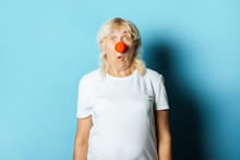 Old Woman With A Red Nose Of A...