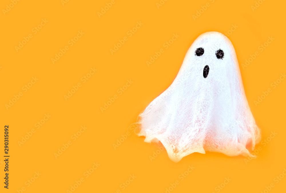 Fototapety, obrazy: Halloween white spooky ghost spirit on orange backgrounds. Minimal concept scary autumn.
