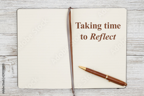 Obraz Taking time to reflect on brown journal with pen on a weathered whitewash wood - fototapety do salonu
