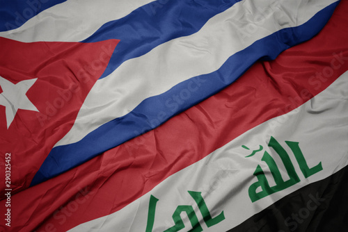 Fényképezés  waving colorful flag of iraq and national flag of cuba.