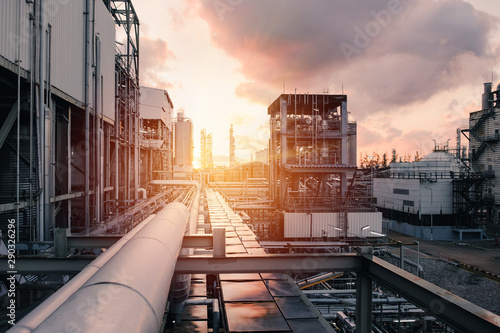 Pipeline and pipe rack of industrial plant with sunset sky background, Manufactu Fototapeta