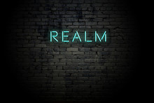 Highlighted Brick Wall With Neon Inscription Realm