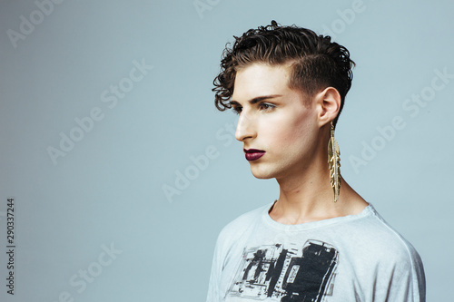 Profile portrait of a young  man with make up and earring Fototapeta
