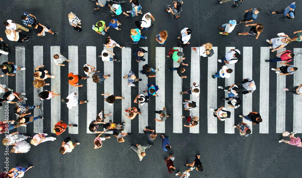 Fototapeta Aerial. Pedestrians on pedestrian crosswalk. Top view.
