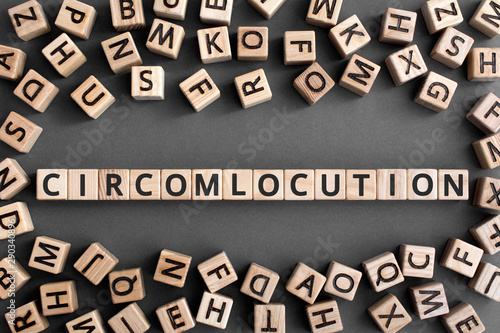 Photo Circumlocution - word from wooden blocks with letters, an indirect way of saying