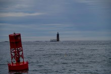 Ram Island Ledge Light Station Lighthouse On The Sea With Red Buoy