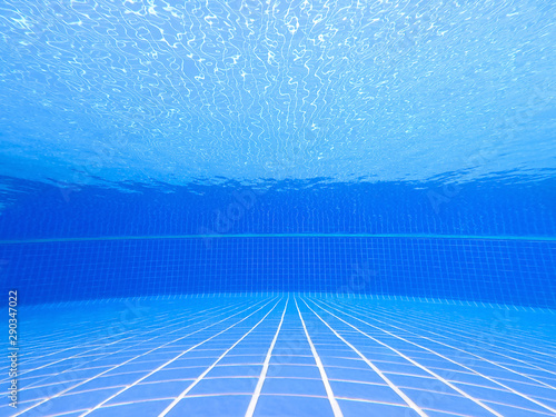 Fototapeta  Underwater shot of the swimming pool with blue tile and clear water background