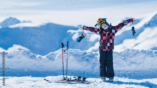 fototapeta na drzwi i meble Child on Top of the Mountain, Smiling, Enjoying Winter