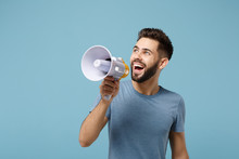 Young Cheerful Funny Man In Casual Clothes Posing Isolated On Blue Wall Background, Studio Portrait. People Sincere Emotions Lifestyle Concept. Mock Up Copy Space. Scream In Megaphone, Looking Aside.