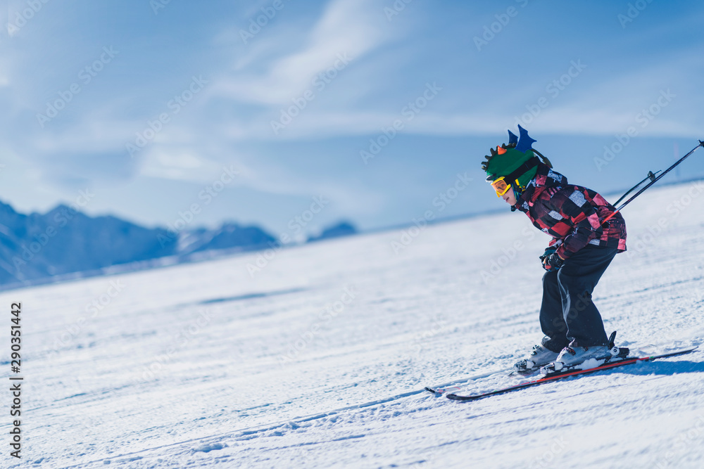 Fototapety, obrazy: Child Skiing in the Mountains