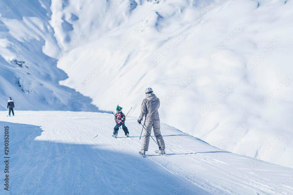 Fototapety, obrazy: Mother and Son Skiing Together