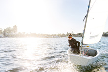 Teenage Boy Sailing An Optimis...