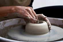 Hands Making Pottery In Worksh...