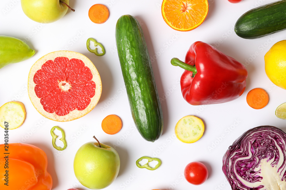 Fototapeta Different vegetables and fruits on white background, top view