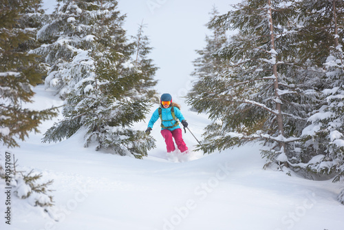 young feemale skiing offpiste
