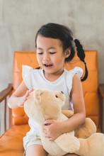 Asian Kid With Her Teddy Bear ...