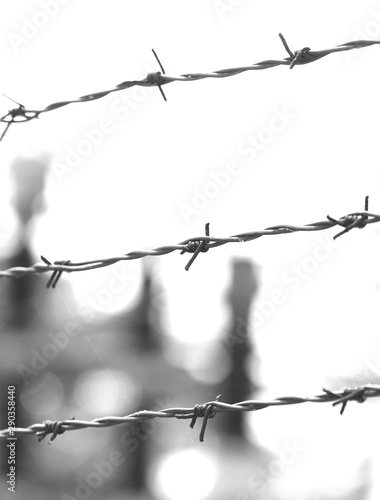 Photo  three dramatic lines of wire thrown into a prison camp