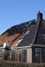 Old Farmhouse With Burned Down Roof