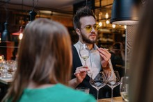 Wine Expert Talking About Wine At Restaurant