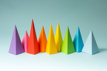 Rainbow Pyramid Shapes Arranged On A Bright Blue Background. (1)