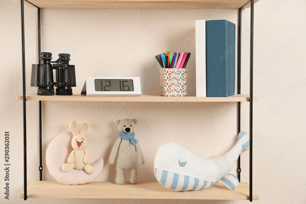 Fototapety, obrazy: Shelves with toys and kids stuff in child room