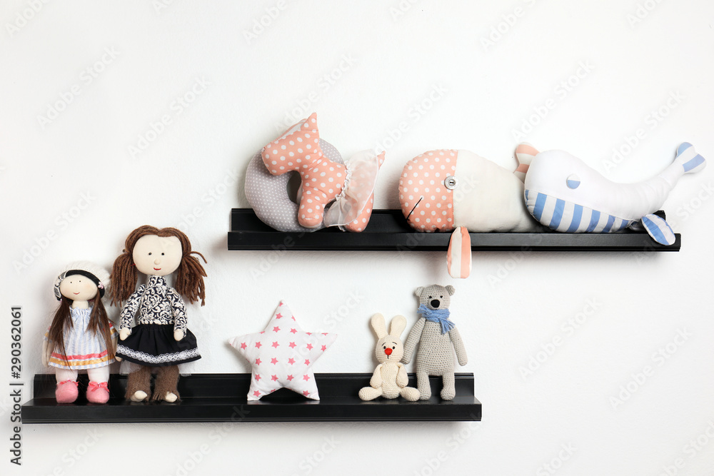Fototapety, obrazy: Different stuffed toys on shelves in child room