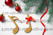 Leinwandbild Motiv Flat lay composition with Christmas decorations and notes on music sheet