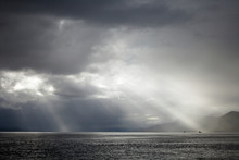 Sunrays On Distant Ships