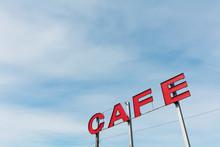 Large CAFE Billboard Against Blue Sky