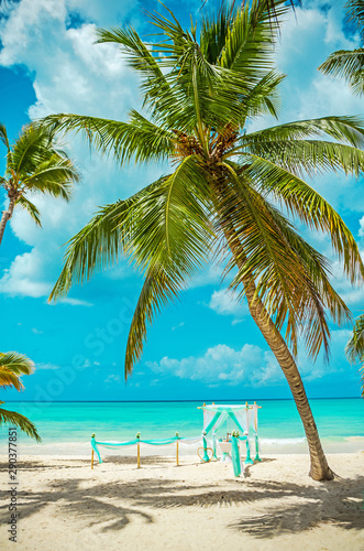 Wedding archway are arranged on the sand in preparation for a beach wedding ceremony Fototapeta