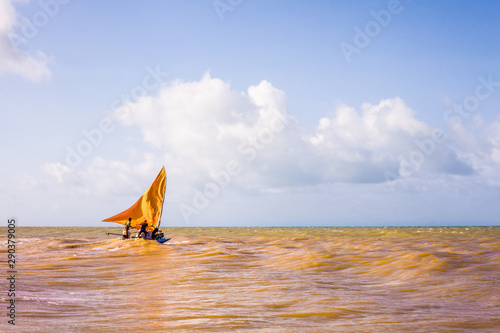 Photo Stands Shipwreck Yellow sail boat sailing, going to sea for another fishing.