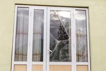 A Broken Glass Window In An Aluminum Frame Door. Door Is Padlocked