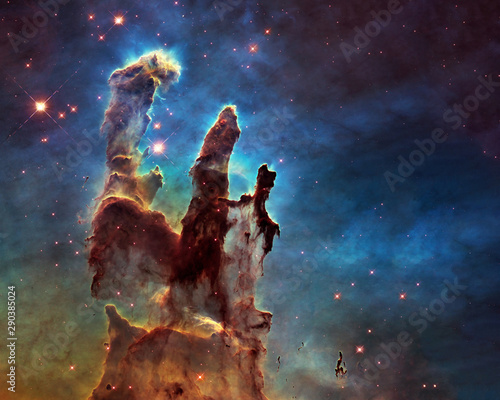 Somewhere in space near Pillars of creation. Science fiction. Elements of this image were furnished by ESA