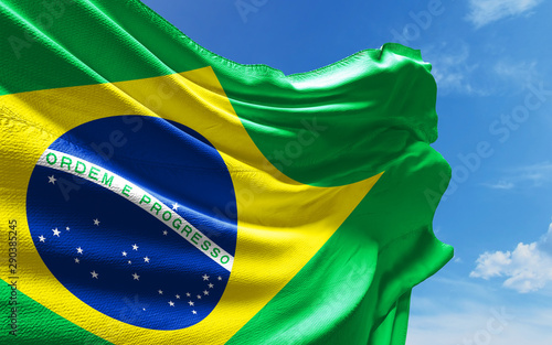 Fototapeta  Brazilian Flag is Waving Against Blue Sky with Clouds