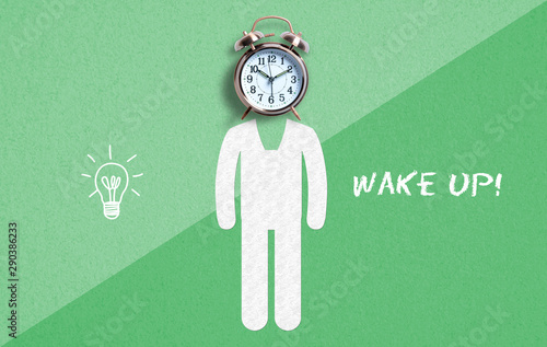 alarm clock as a head on a drawn person and text time to wake up on paper back Canvas Print