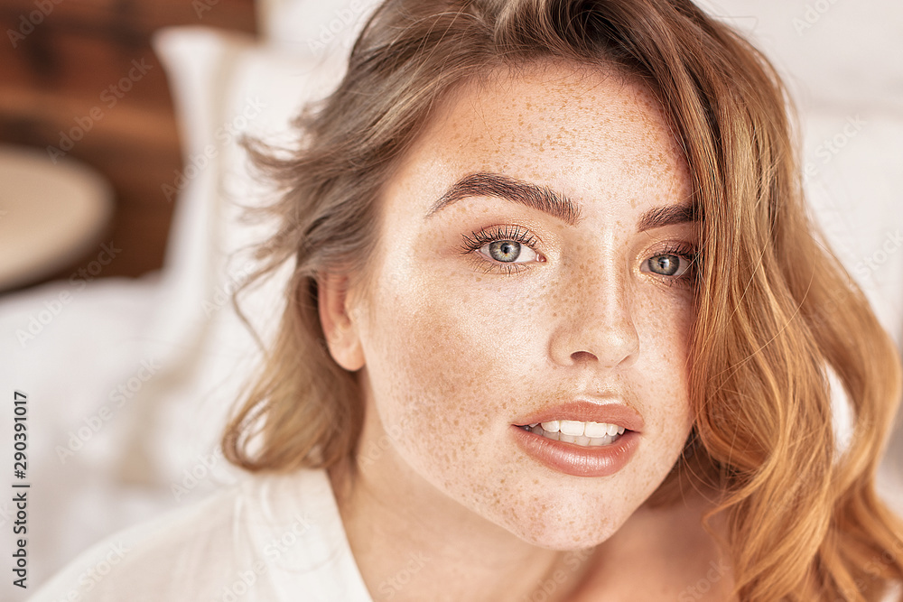 Fototapety, obrazy: Beauty portrait of woman with freckles.
