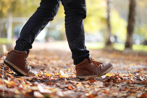 Stickers pour portes Route dans la forêt Autumn Park man walking along a path foliage