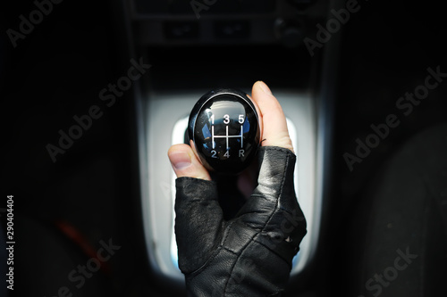Gear lever. Manual Transmission. Hand on the gear shift in a car. Fototapeta