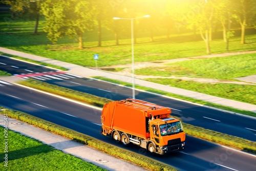 Foto auf AluDibond Melone Garbage truck . Orange garbage truck . Urban recycling waste and garbage services