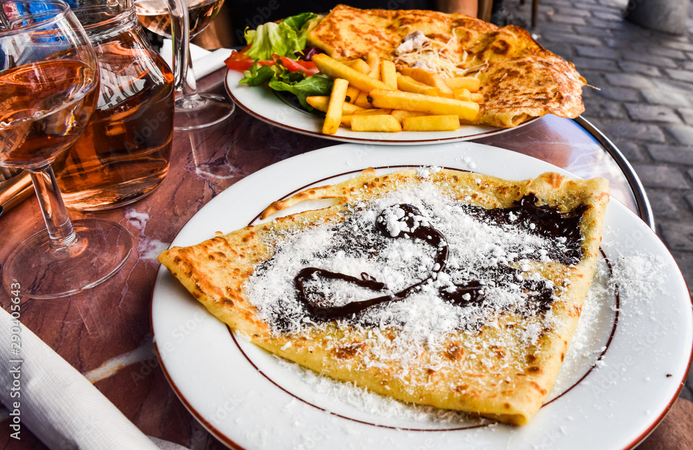 Fototapeta Crepe/crep/crepas is a very popular dish widespread in France, Belgium, Canada, and many parts of Europe,  This one here is a sweet crepe with chocolate and glazed sugar.