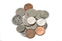 An Assorted Pile Of Modern Canadian Coins Isolated, Up Close In Macro, On A Clean White Background
