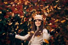 Happy Woman Throwing Autumn Leaves Enjoying Nature