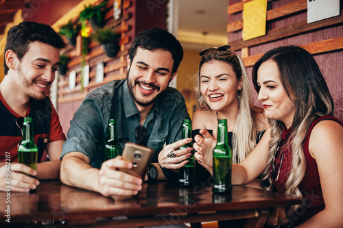 Group of friends having a good time at the bar