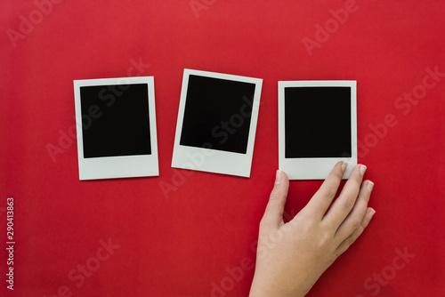 Obraz blank polaroids on a red background - fototapety do salonu