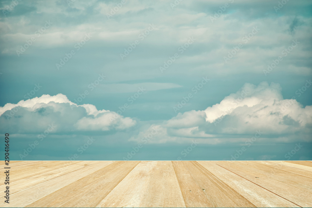 Fototapeta Wooden table top on blue sky with clouds for background