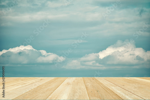 fototapeta na drzwi i meble Wooden table top on blue sky with clouds for background