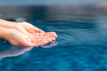 Closeup Image Of Hands Scoopin...