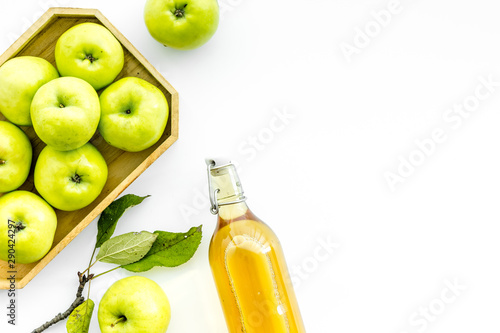 Apple cider in bottle near tray with fruits on white background top view copy sp Fototapeta