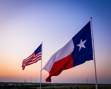 American And Texas Flags Against Sky | Flags At Sunset With Heavy Vignette
