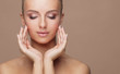 Leinwandbild Motiv Beautiful face of young and healthy woman. Skin care, cosmetics, makeup, complexion and face lifting.